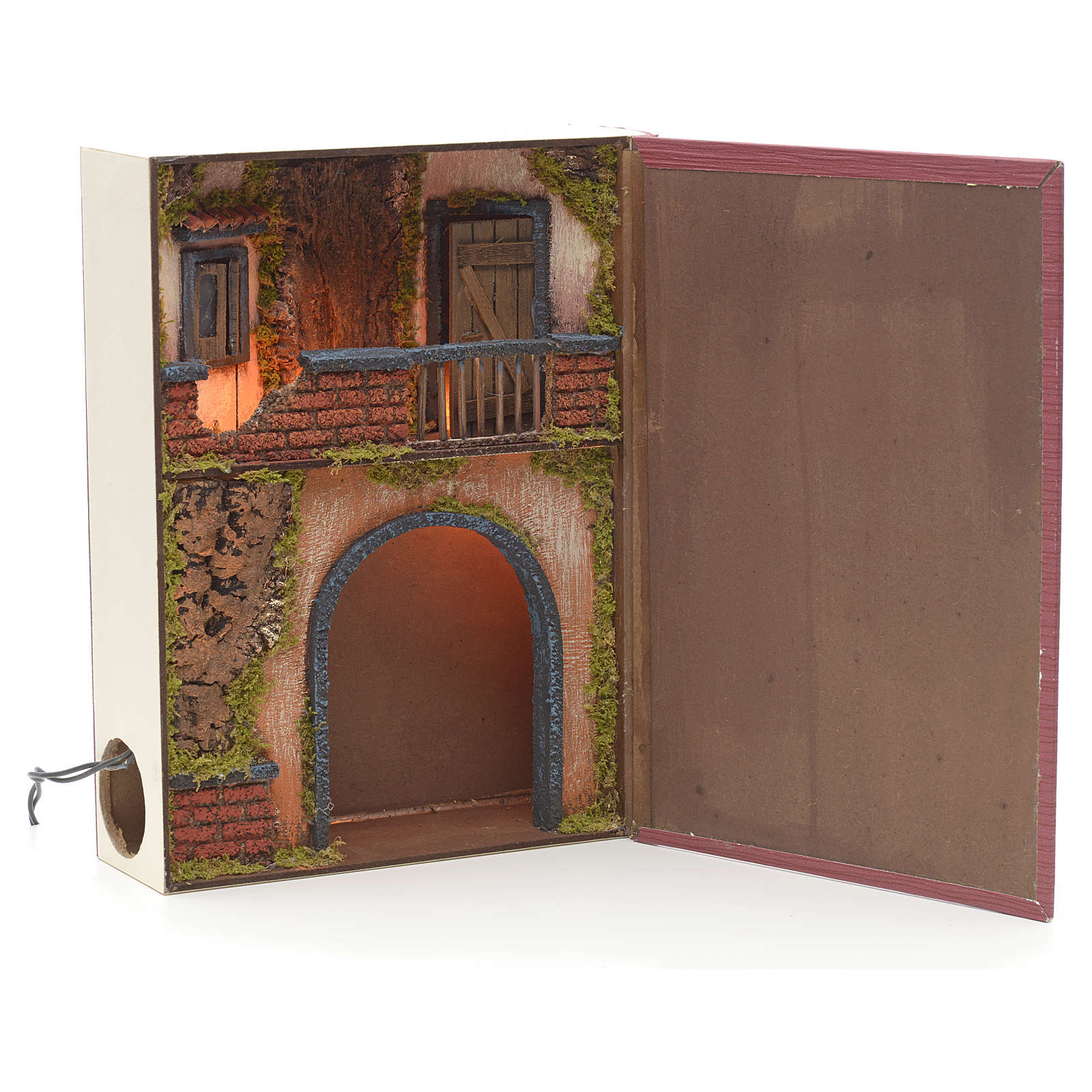 Illuminated village with balcony for nativities inside a book 30 4