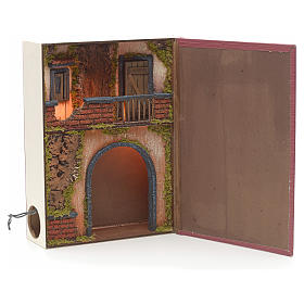 Illuminated village with balcony for nativities inside a book 30 s1
