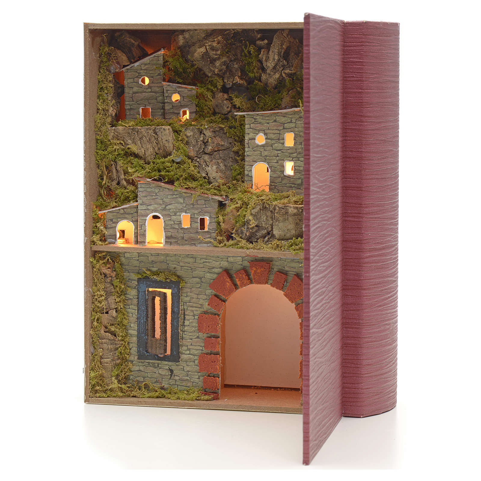 Illuminated village with grotto for nativities inside a book 24x 4