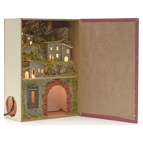 Illuminated village with grotto for nativities inside a book 24x 1