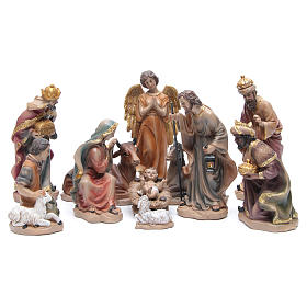 Resin nativity set measuring 20.5cm, 11 figurines with golden finish s1
