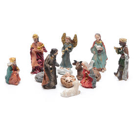 Mini nativity set in resin measuring 3.3cm, 11 figurines with soft colours s1