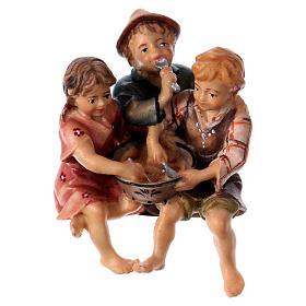 Estatua grupo niños sentados belén Original madera pintada Val Gardena 10 cm de altura media s1