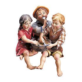 Statuetta gruppo bambini seduti presepe Original legno dipinto Valgardena 10 cm s1