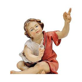 Bambino seduto al falò presepe Original legno dipinto Valgardena 10 cm s2
