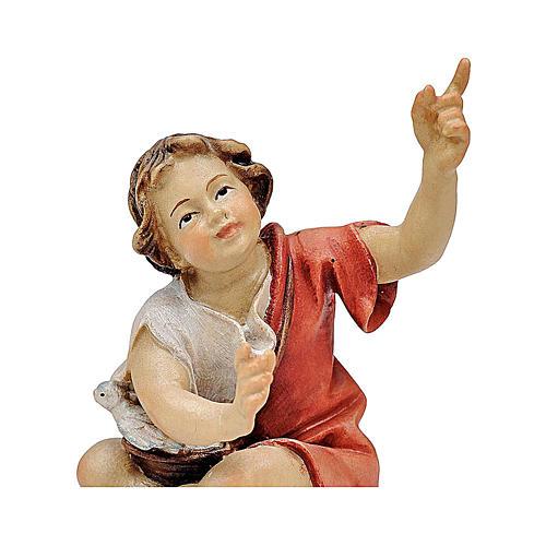 Bambino seduto al falò presepe Original legno dipinto Valgardena 12 cm 2