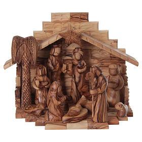 Crèche bois d'olivier de Jérusalem: Cabane avec crèche en olivier de Bethléem stylisée 20x25x20 cm