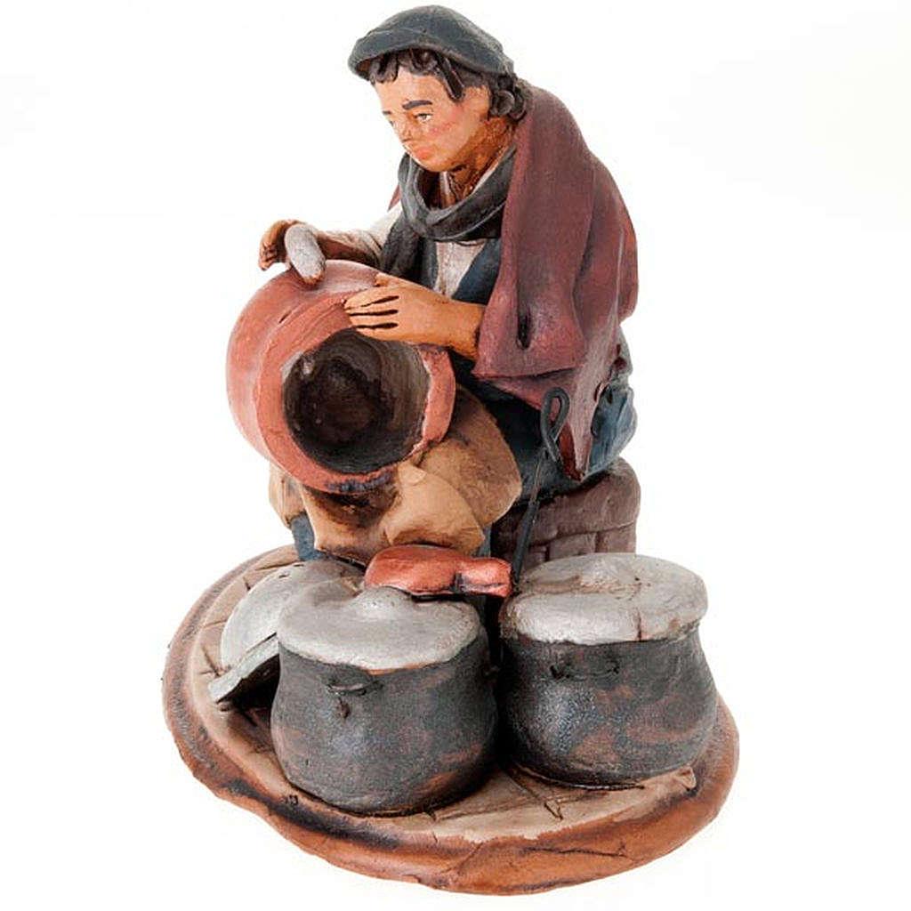 Santon crèche de Noël homme avec cocottes 4