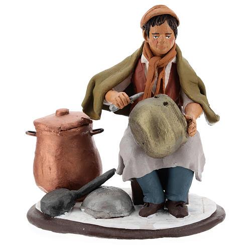 Santon crèche de Noël homme avec cocottes 1