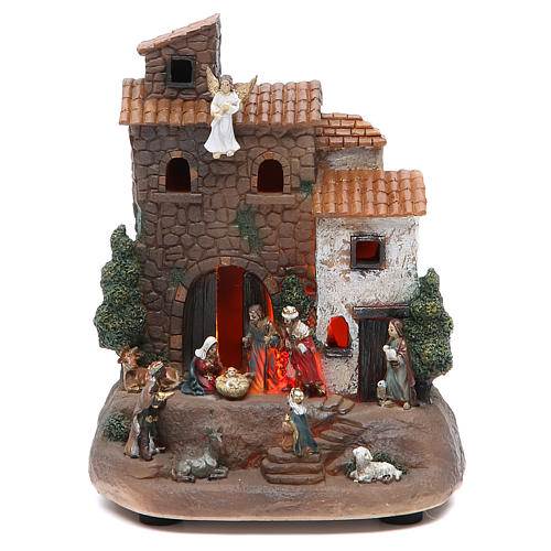 Holy family with house measuring 17cm, in resin 1
