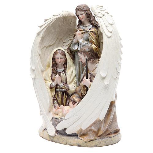 Sacra Famiglia con angelo 31 cm resina 2
