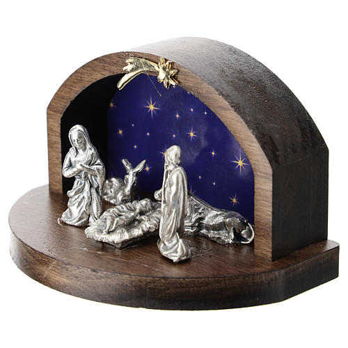 Nativity in metal with curved wood shack 5 cm 2