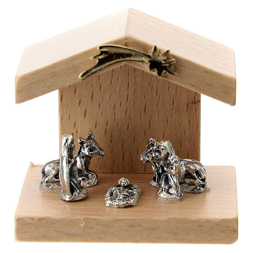 Nativity in metal with pear wood shack 5 cm 1