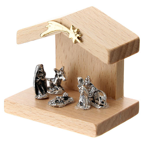 Nativity in metal with pear wood shack 5 cm 2
