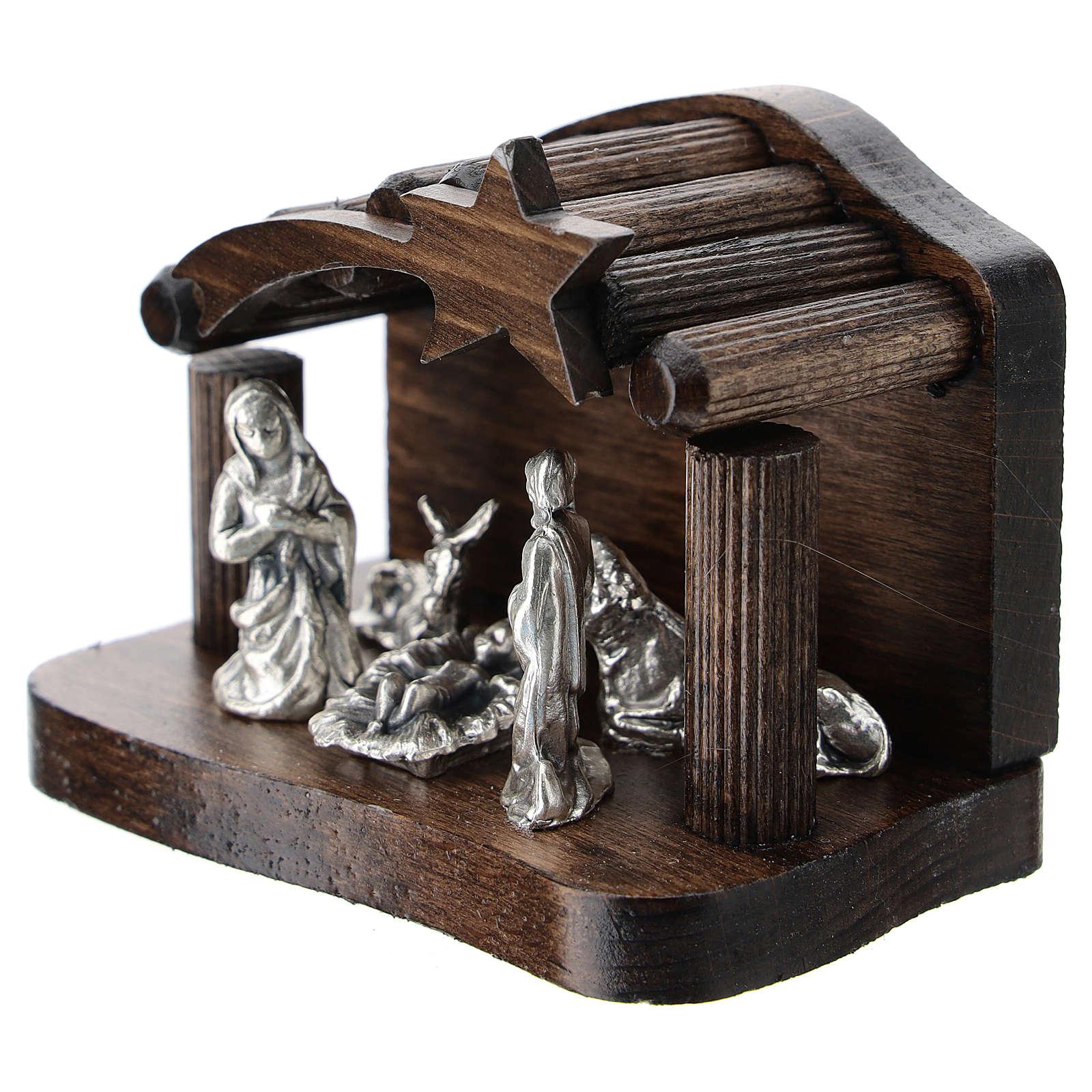 Nativity in metal with dark wood shack 5 cm 3