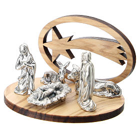 Nativity in metal with wood star 5 cm s2