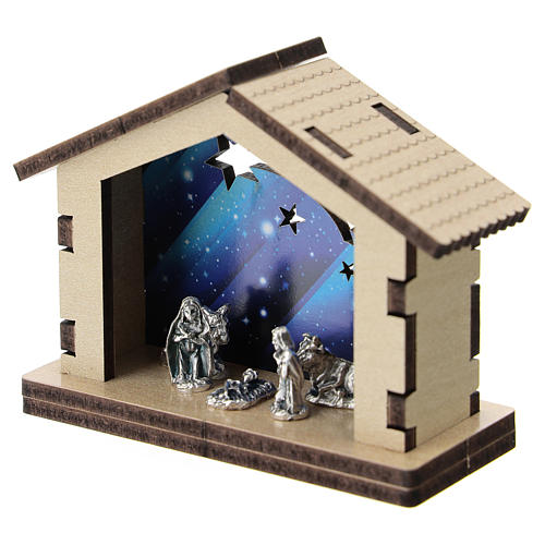 Nativity in metal with wood shack and printed sky in the background 5 cm 2