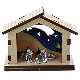 Nativity in metal with wood shack and printed desert in the background 5 cm s1