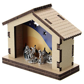 Nativity in metal with wood shack and printed desert in the background 5 cm s2