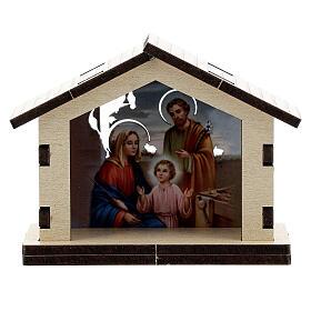 Sacra Famiglia su sfondo di capanna il legno s1