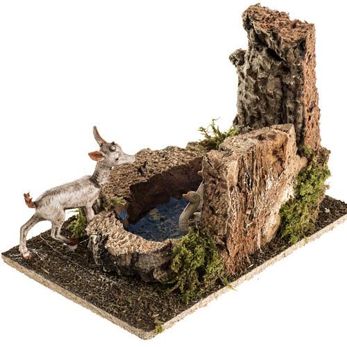Chèvre avec oies dans bassin milieu crèche Noel 2