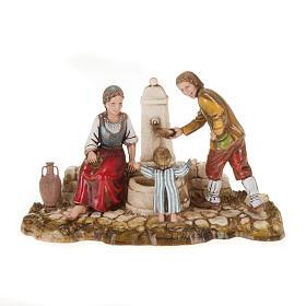 Statue per presepi: Ambientazione presepe Moranduzzo famiglia alla fontana 10 cm