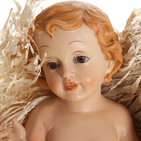 Baby Jesus figurine in pvc laying on straw, various sizes s2