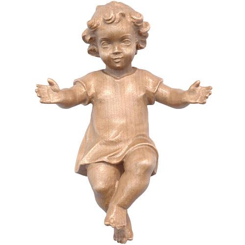 Gekleidetes Jesuskind aus Holz des Grödner Tals patiniert 1