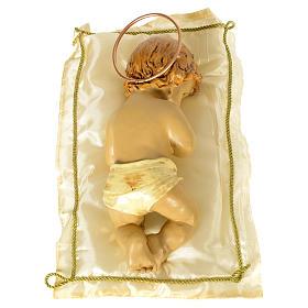 Enfant Jésus avec coussin et auréole h 25 cm résine s2