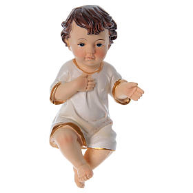 Baby Jesus figurines: Baby Jesus with white clothes in resin real height 10 cm