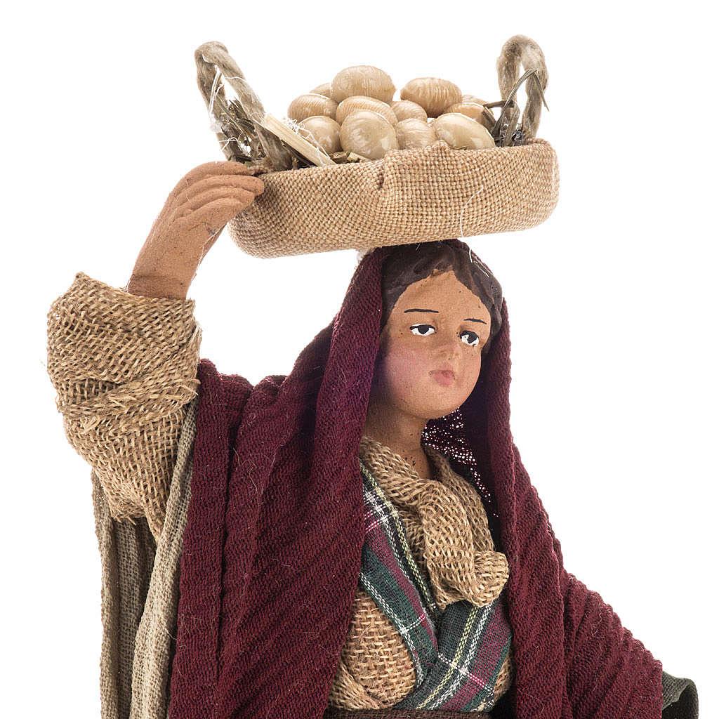 Donna con ceste di uova 14 cm 4
