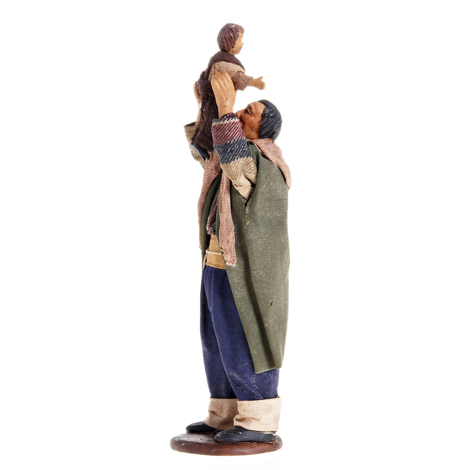 Nativity figurine man lifting up child 14cm 4
