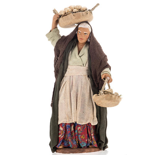 Donna anziana con uova 14 cm 1