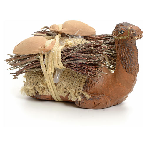 Neapolitan Nativity figurine, kneeling camel with wood bundle, 8 2