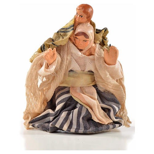 Neapolitan Nativity, Arabian style, woman with baby on shoulders 1