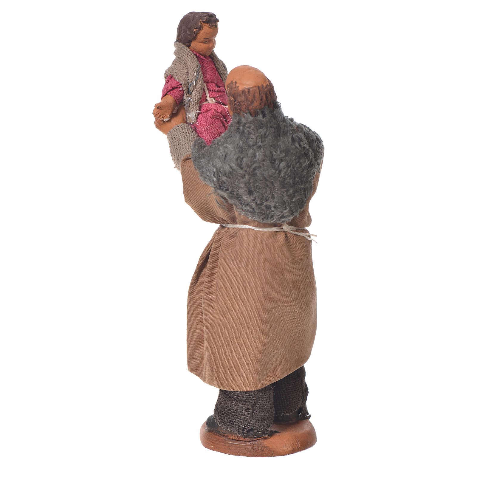 Homme soulevant un enfant 10 cm crèche napolitaine 4