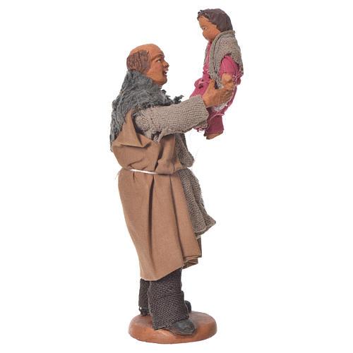 Homme soulevant un enfant 10 cm crèche napolitaine 1