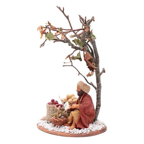 Mercante con sacco di semi con albero 10 cm presepe Napoli 2