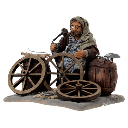 Man fixing wheels 10cm neapolitan Nativity 2