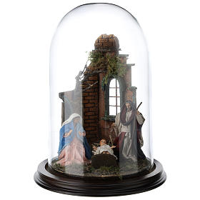 Neapolitan nativity scene on a wooden base with a glass domed roof s1