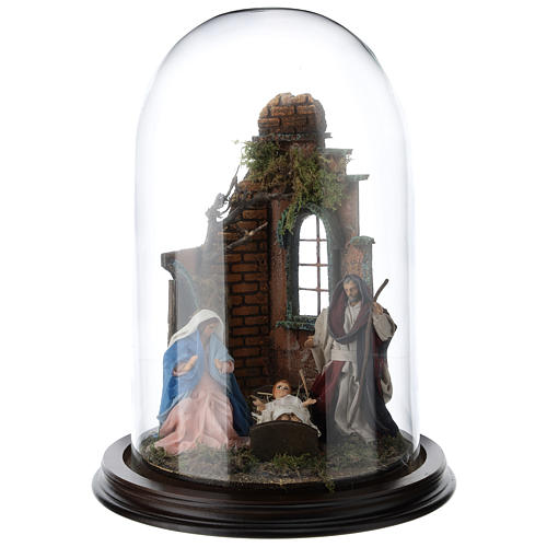Neapolitan nativity scene on a wooden base with a glass domed roof 1