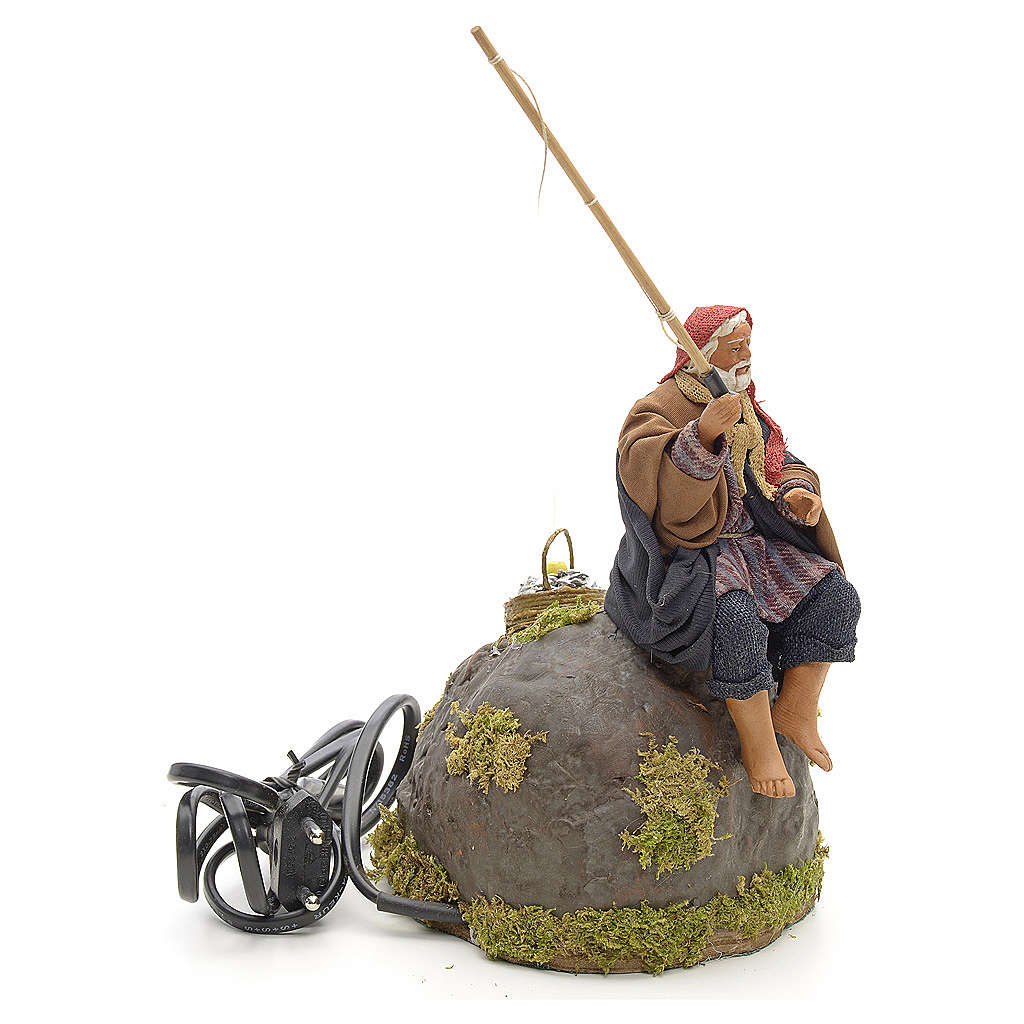 Pêcheur animé sur rocher crèche 12 cm 4