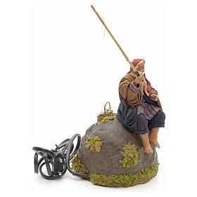 Pêcheur animé sur rocher crèche 12 cm s15