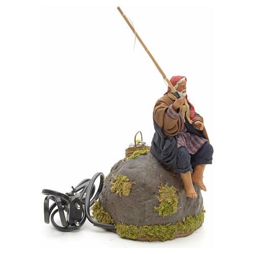 Pêcheur animé sur rocher crèche 12 cm 15