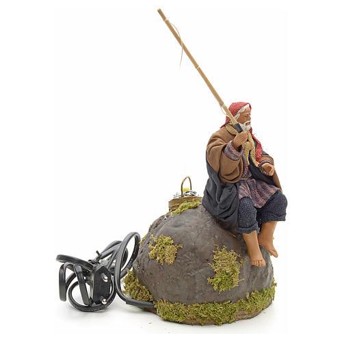 Pêcheur animé sur rocher crèche 12 cm 5