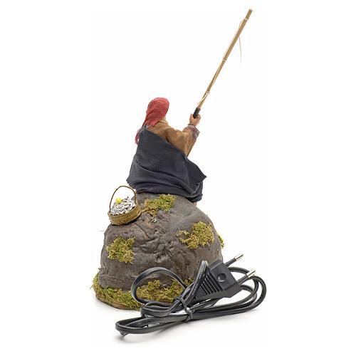 Pêcheur animé sur rocher crèche 12 cm 11