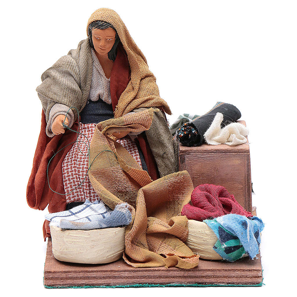 Animated nativity scene, woman sewing 12 cm 4