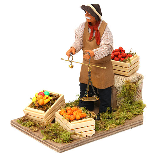 Animated Nativity scene figurine, greengrocer with scales 14 cm 2