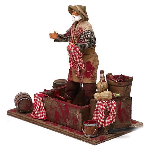 Animated Nativity scene figurine,  grape stomping man 14 cm 2
