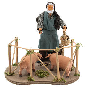 Animated Nativity scene figurine, man feeding pigs 14cm s1